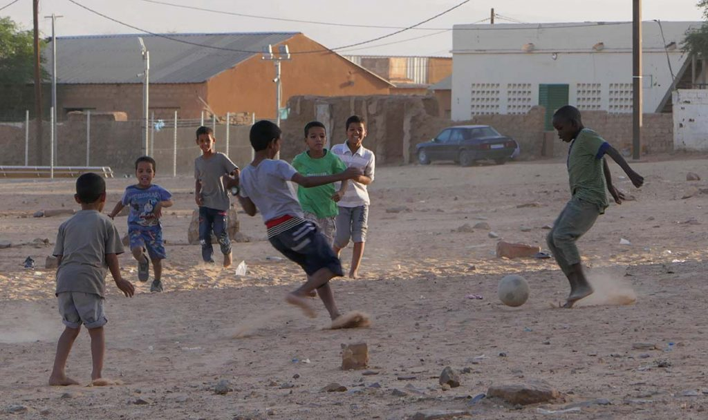 Boys Playing Football on Sandy Lot in Atar - Mauritania