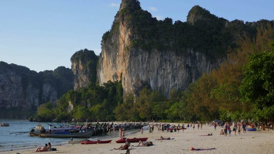 Railay Beach with Longtail Boats and Limestone Formations in Thailand