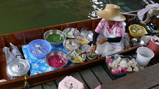 Woman Selling Food at Taling Chan Floating Market in Bangkok - Thailand