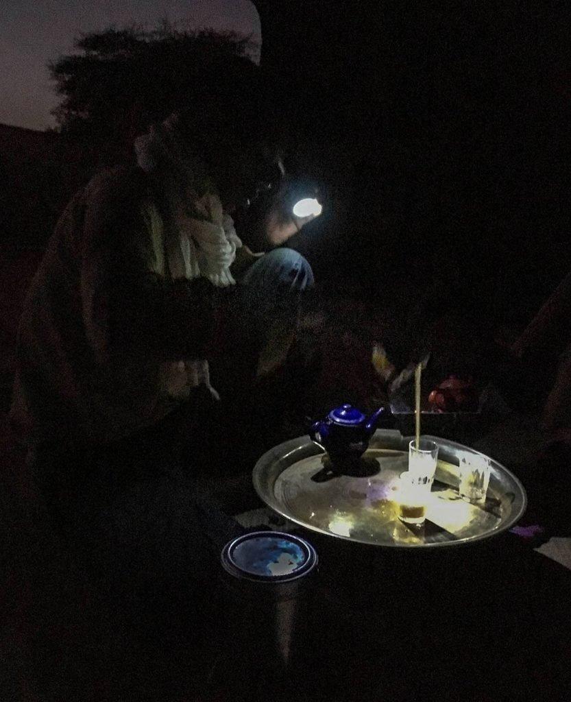Nomad Making Tea by Flashlight in the Sahara Desert at Dusk - the Adrar - Mauritania