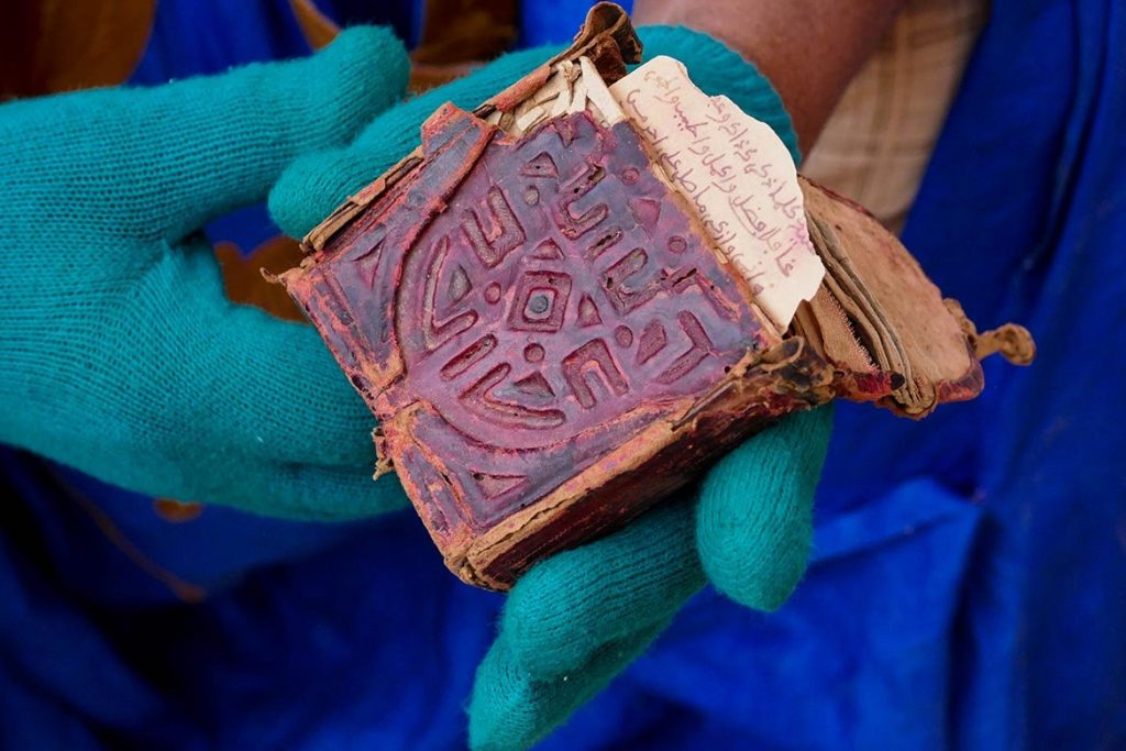 Old Miniature Book at the Ancient Library in Chinguetti - Mauritania