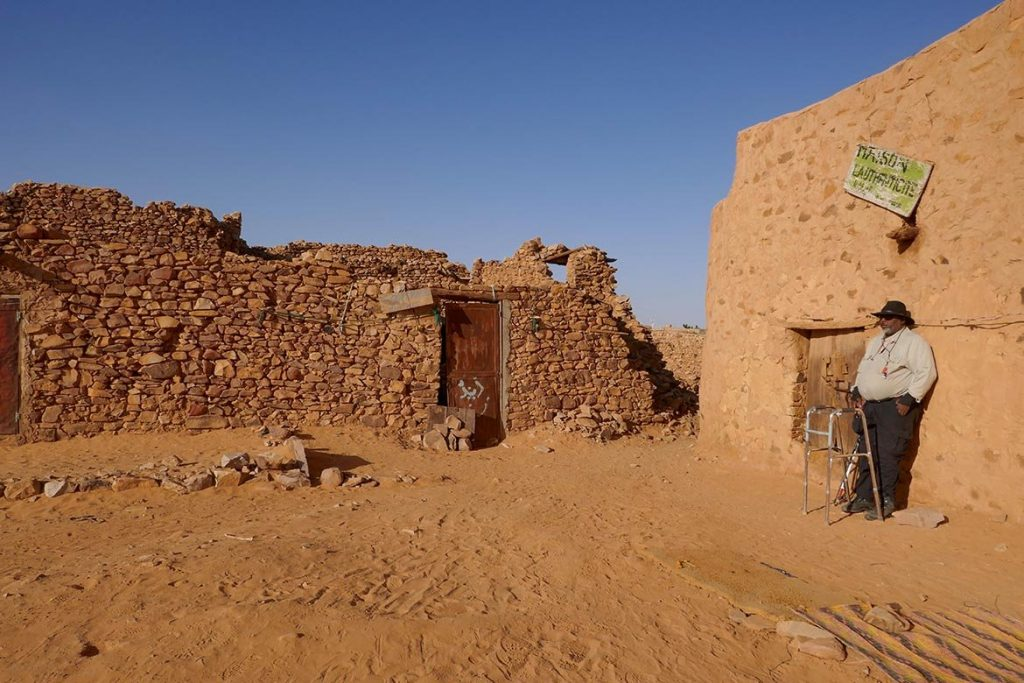 Tim Waiting for Caretaker in Courtyard at Ancient Library in Chinguetti - Mauritania