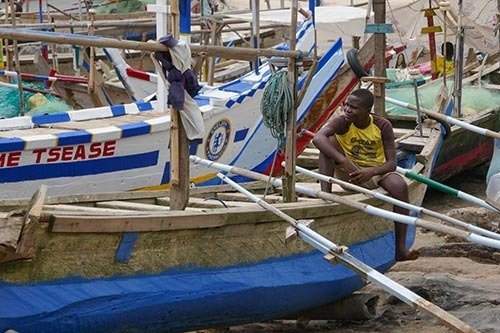 Young-Ghanaian-Sitting-on-Boats-in-Fishing-Village