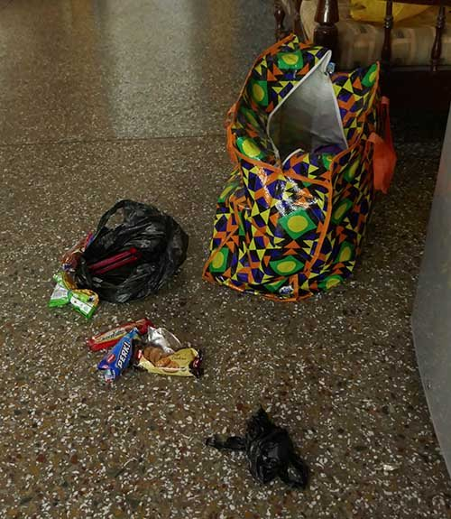 Fallen bag and snacks on floor after baboon visit - Baboons are criminals in northern Ghana