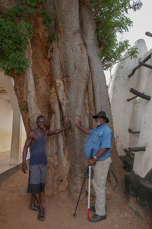 Tim with Mosque Storyteller at the Baobob Tree in Larabanga