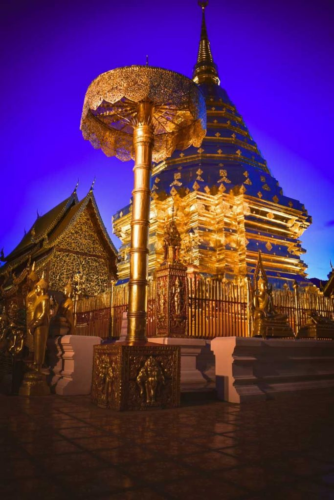 Wat Phra That Doi Suthep in Chiang Mai - an elaborate golden temple as seen at night