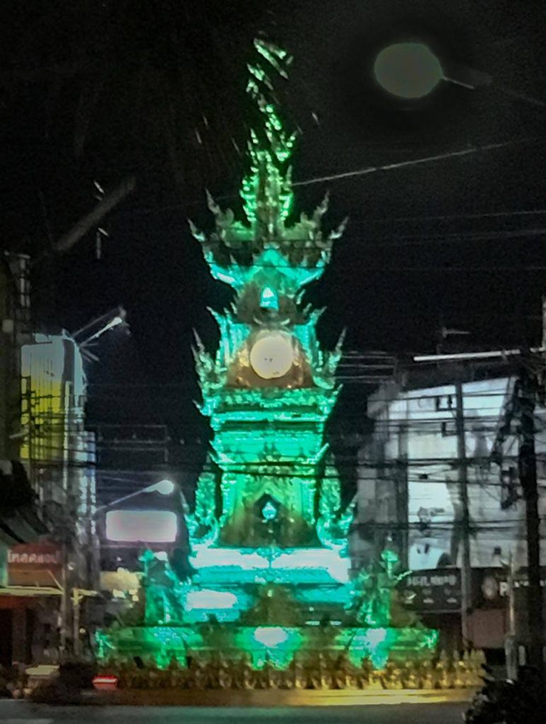 Chiang Rai Clock Tower glowing green from Light Show