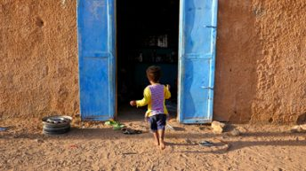 Little Girl Running into house in Mauritania